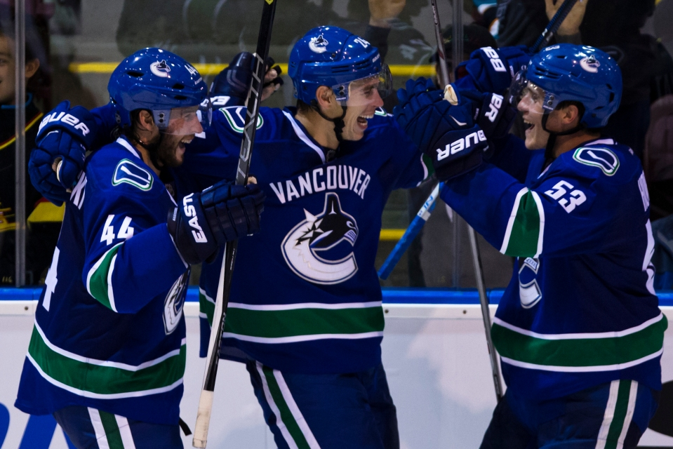 Vancouver Canuck Adam Cracknell celebrates after scoring the only goal of the game in overtime versus the San Jose Sharks winning the Kraft Hockeyville exhibition game for the Canucks on September 21, 2015 at the Q centre in Colwood B.C. Canada. (Photo by Kevin Light/SanJose Sharks)