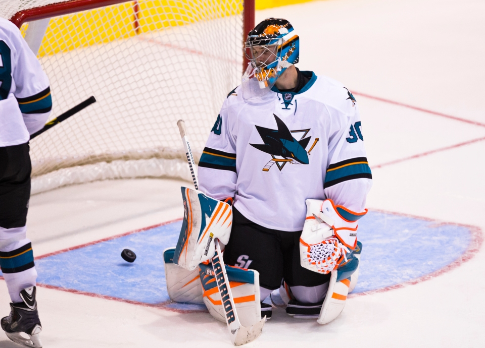San Jose Sharks goaltender Aaron Dell sits in his crease after Vancouver Canuck Adam Cracknell scored the only goal of the game in overtime winning the Kraft Hockeyville exhibition game for the Canucks on September 21, 2015 at the Q centre in Colwood B.C. Canada. (Photo by Kevin Light/SanJose Sharks)