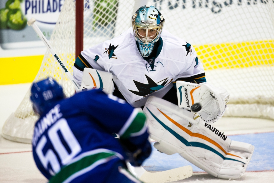 San Jose Sharks goaltender Troy Grosenick makes a glove save on Vancouver Canuck Brendan Gaunce during their Kraft Hockeyville exhibition game on September 21, 2015 at the Q centre in Colwood B.C. Canada. (Photo by Kevin Light/SanJose Sharks)