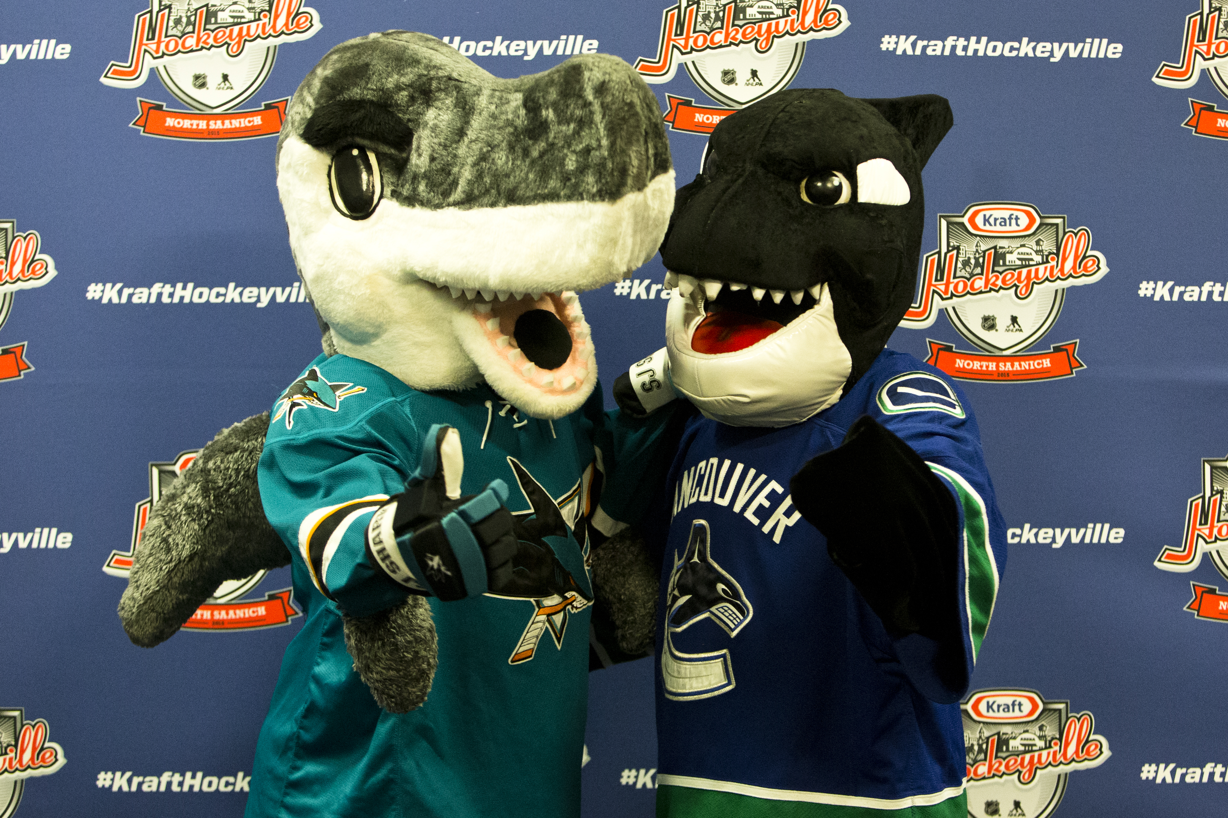 San Jose Shark mascot Sharkie and Vancouver Canucks mascot Fin pose for a  photo prior to 64feb2c6f