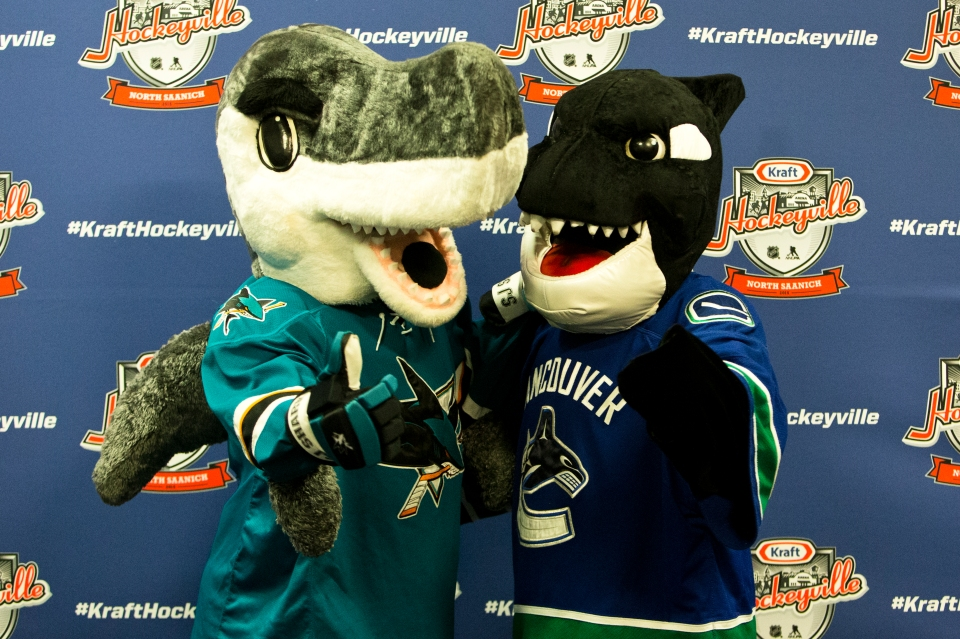San Jose Shark mascot Sharkie and Vancouver Canucks mascot Fin pose for a photo prior to the Kraft Hockeyville exhibition game between the Sharks and Canucks on September 21, 2015 at the Q centre in Colwood B.C. Canada. (Photo by Kevin Light/SanJose Sharks)
