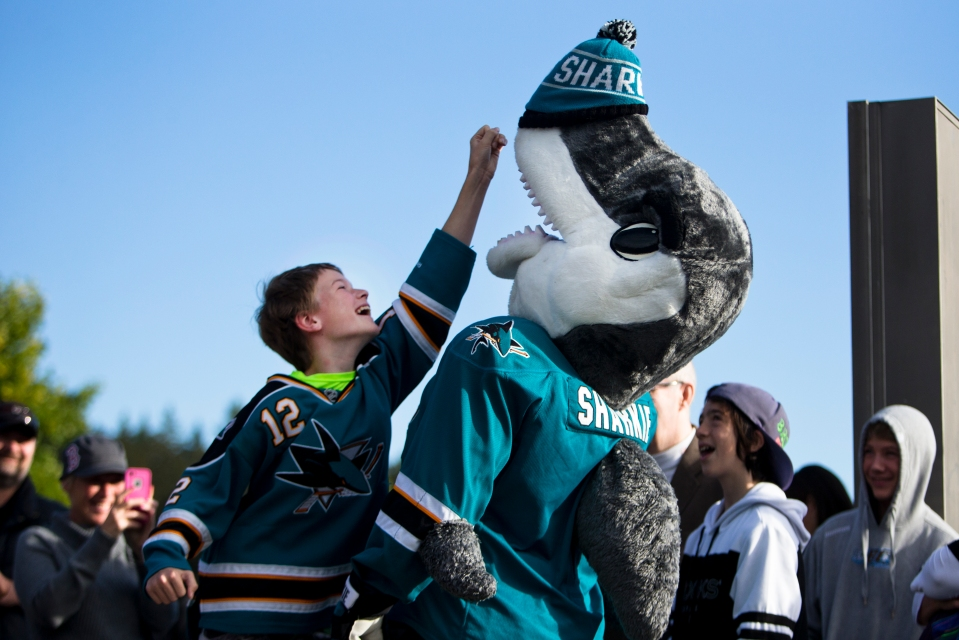A young San Jose Shark fan wearing a Patrick Marleau jersey tries to grab his toque off Shark mascot Sharkie's nose prior to the Kraft Hockeyville exhibition game between the Vancouver Canucks and San Jose Sharks on September 21, 2015 at the Q centre in Colwood B.C. Canada. (Photo by Kevin Light/SanJose Sharks)