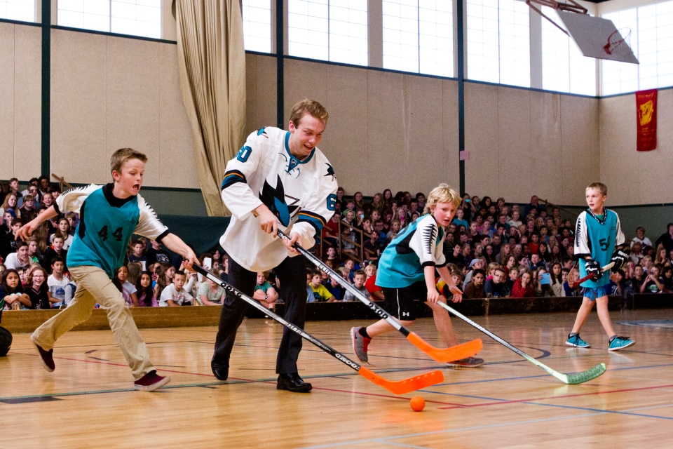 Rourke Chartier of the San Jose Sharks along with Vancouver Canuck Frank Corrado visit Bayside middle school for a game of ball hockey prior to their Kraft Hockeyville exhibition game on September 21, 2015 being played at the Q centre in Colwood B.C. Canada. (Photo by Kevin Light/SanJose Sharks)