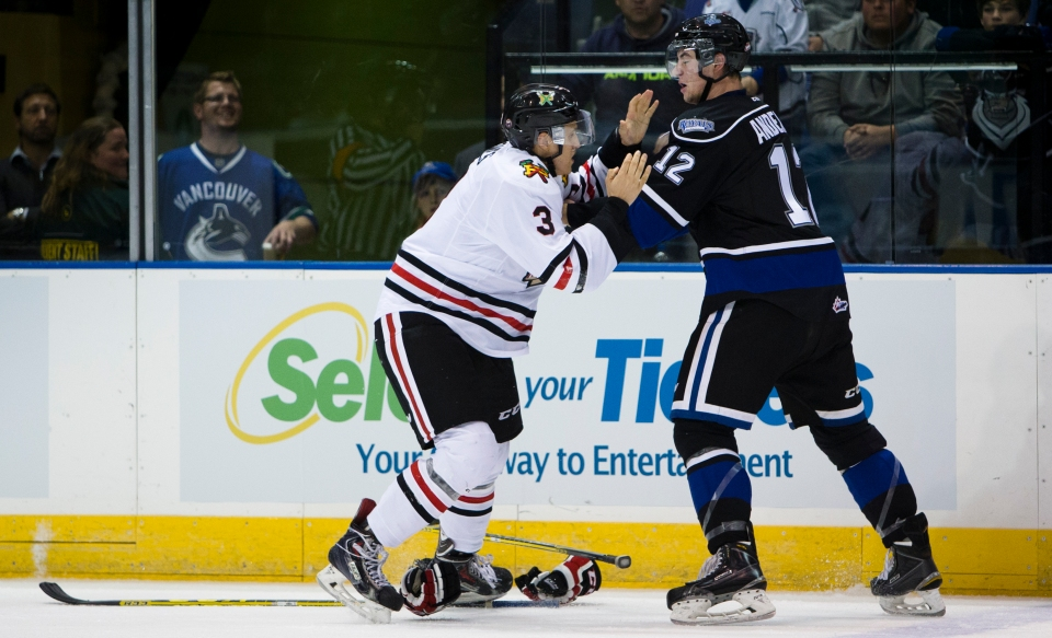 Portland Winterhawk defenceman Caleb Jones goes for the judo chop manoeuvre during a fight with Victoria Royal Keith Anderson.