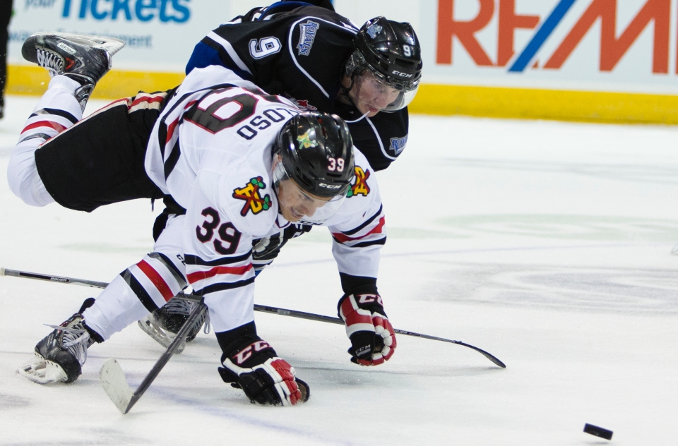 Portland Winterhawk Colton Veloso and Victoria Royal Jack Walker battle for the puck during their game at the Save-on-Foods memorial centre. Walker would finish the game a plus one with one goal.