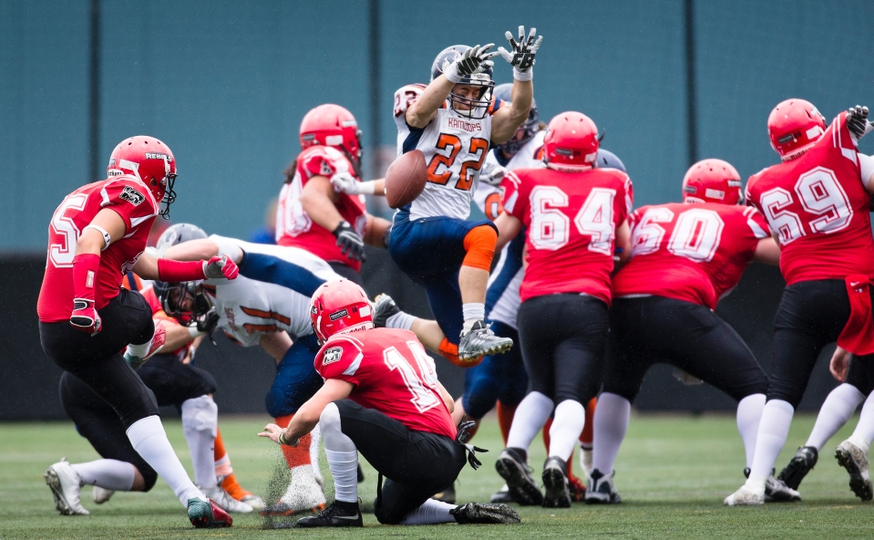 Westshore Rebels Kicker Erikson Deseron has his first quarter field goal attempt blocked by Kamloops Broncos defensive back Derek Trager at Westhills Stadium in Langford B.C. on Saturday August 29, 2015.
