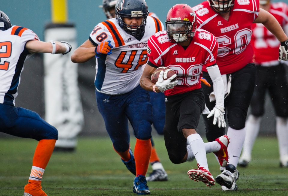 Westshore Rebels receiver Eric Willimas escapes the grasp of linebacker Michael Ochoa during a game versus the Kamloops Broncos at Westhills Stadium in Langford B.C. on Saturday August 29, 2015.