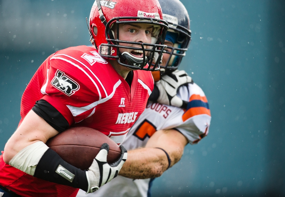 Westshore Rebels receiver Joe Barkhouse stiff arms Jake Bainas on his way downfield during the second half of a game versus the Kamloops Broncos at Westhills Stadium in Langford B.C. on Saturday August 29, 2015.
