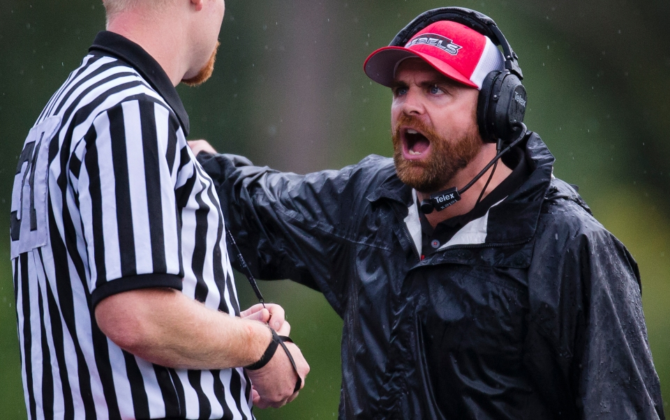 With a six point lead Westshore Rebel head coach JC Boise argues with the official over a time out call during the last minute of the fourth quarter versus the Kamloops Broncos at Westhills Stadium in Langford B.C. on Saturday August 29, 2015.