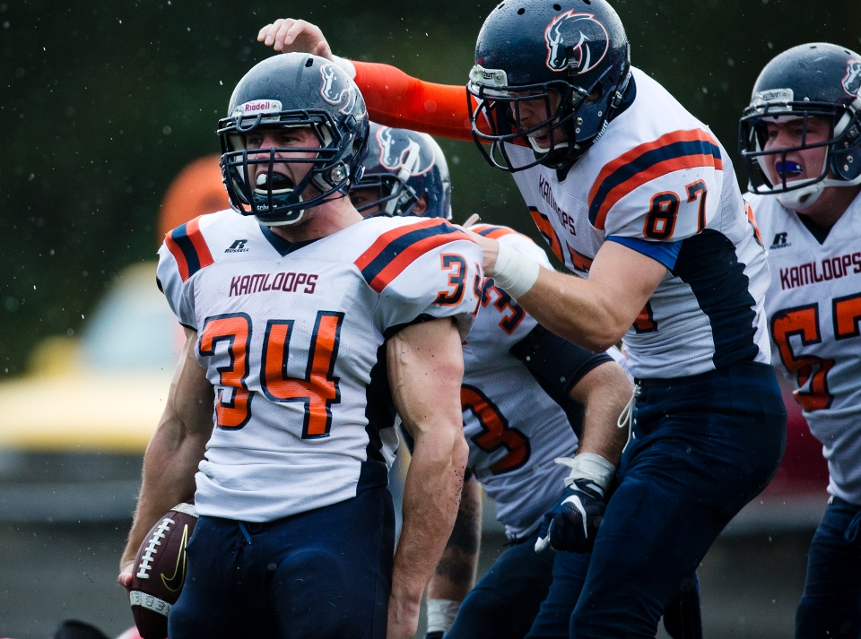Kamloops Broncos running back Jacob Palmarin scores the game winning touchdown with under a minute to play versus the Westshore Rebels at Westhills Stadium in Langford B.C. on Saturday August 29, 2015. The Broncos would go on to beat the Rebels 37-36 for their fourth win of the season.