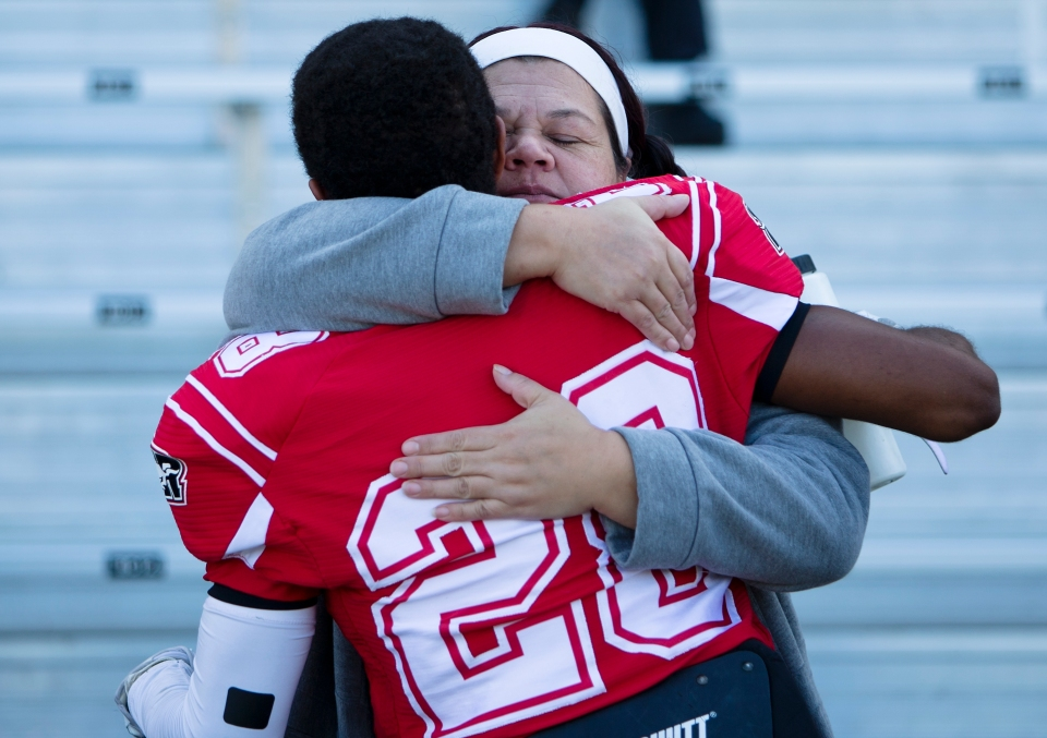 Westshore Rebels Receiver Eric Williams gets a hug prior to a game versus the Kamloops Broncos at Westhills Stadium in Langford B.C. on Saturday August 29, 2015.