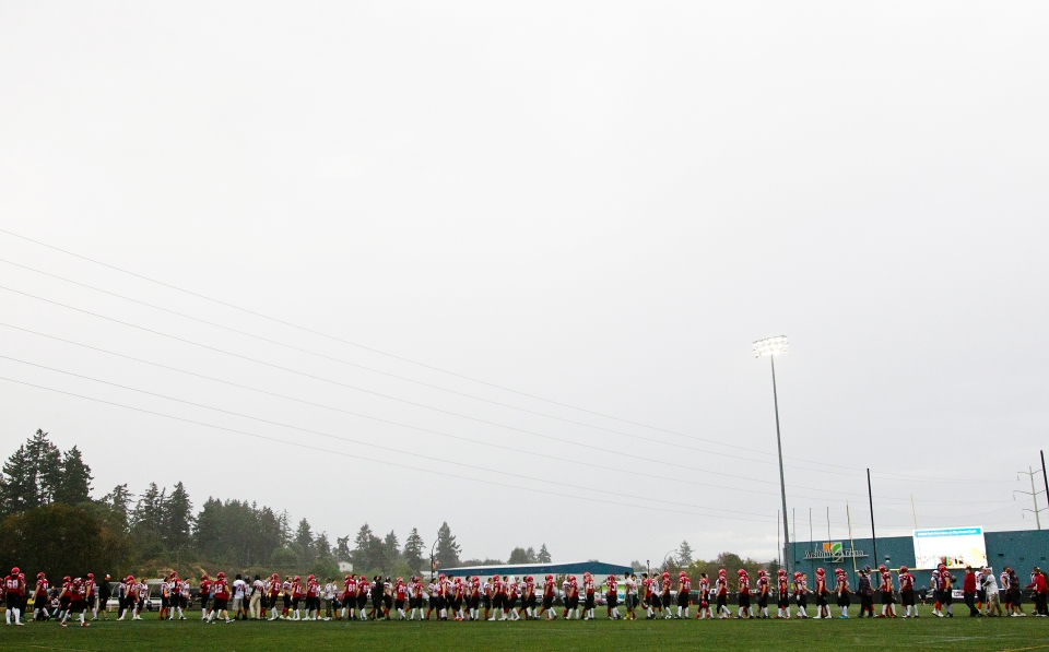 The Kamloops Broncos and Westshore Rebels shake hands following a 37-36 Broncos win at Westhills Stadium in Langford B.C. on Saturday August 29, 2015. The Broncos improved to 4-2 while the Rebels dropped to 1-5