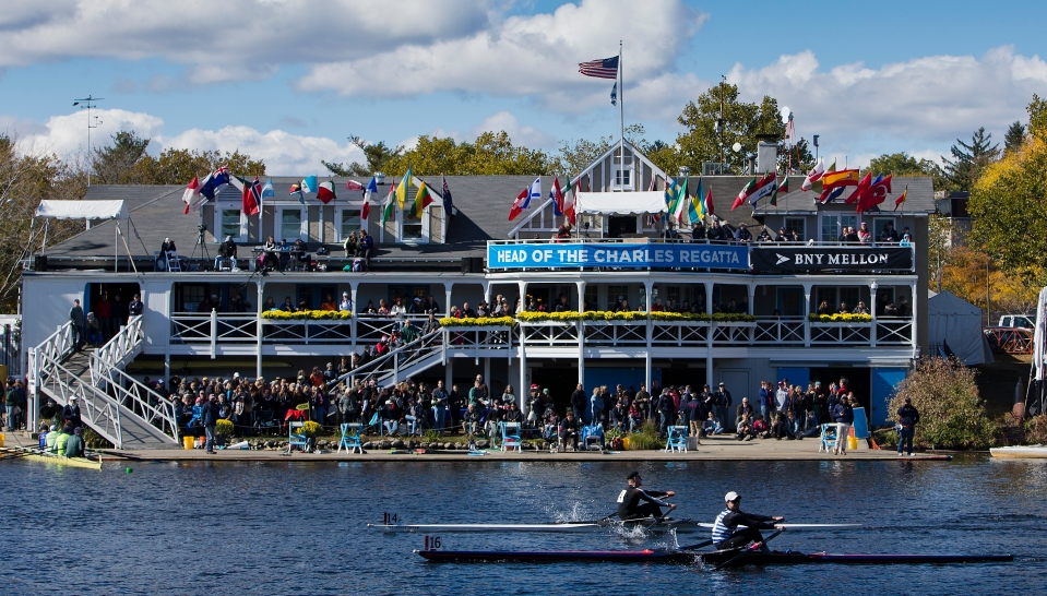 Robert Meenk bow number 14 and Sam Hausmann bow number 16 race past Cambridge Boat Club in the Men's Lightweight Singles event at the Head of the Charles rowing regatta in Boston, Massachusetts on October 18th 2015.