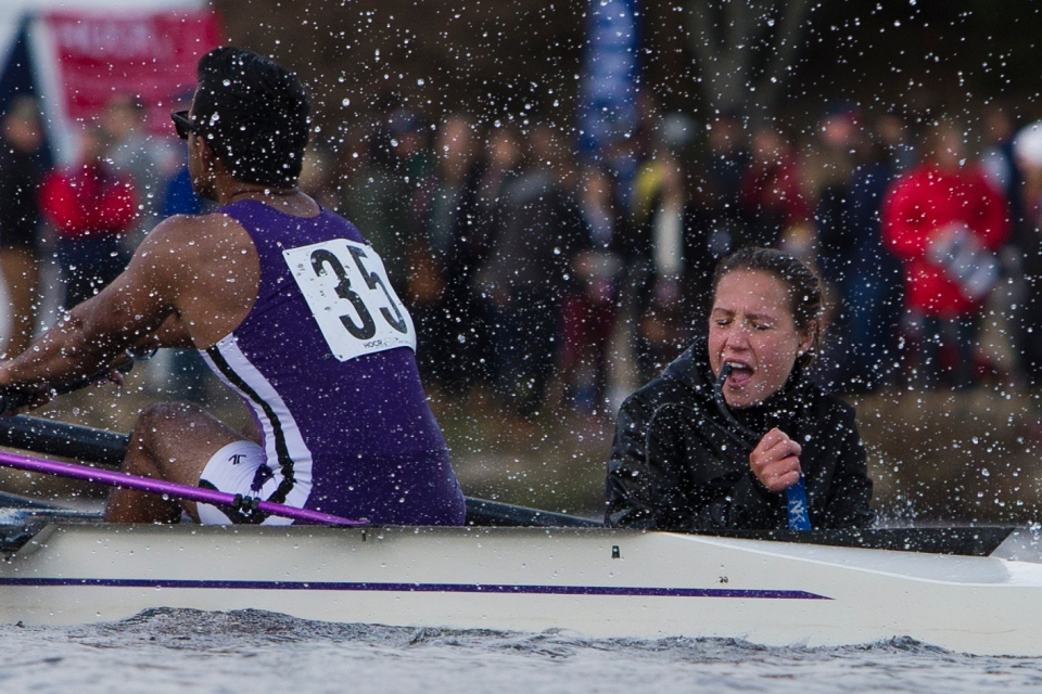 Coxswain Gianna Radelji yells into her microphone as she gets sprayed by her Belmont Hill teammate Szu-raj Kothari while rounding the final bend past the Winsor Boathouse in the Men's Collegiate Fours event at the Head of the Charles rowing regatta in Boston, Massachusetts on October 17th 2015.