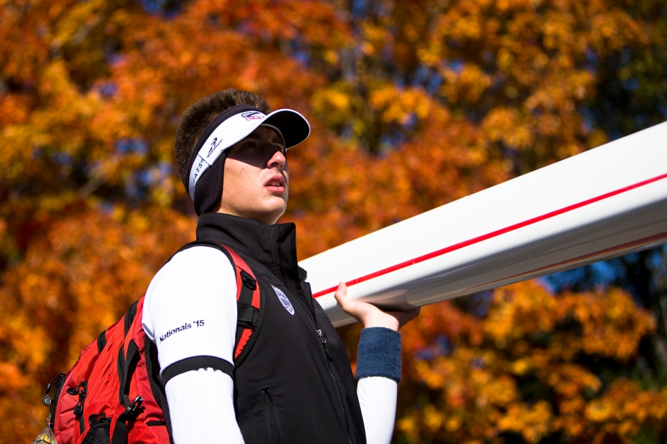 A male rower holds the stern of his boat at the Head of the Charles rowing regatta in Boston, Massachusetts on October 18th 2015.