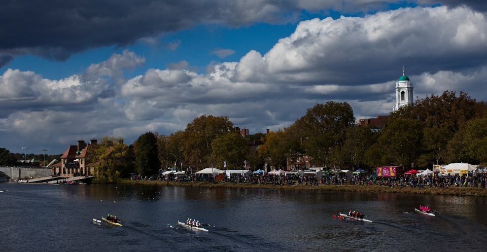 New Canaan Crew, Belmont Hill, CRC/PBC/PENNAC and All-American crews row toward Weld Boathouse after passing under Weeks Footbridge in the Directors' Challenge Men's Quads event at the Head of the Charles rowing regatta in Boston, Massachusetts on October 18th 2015.