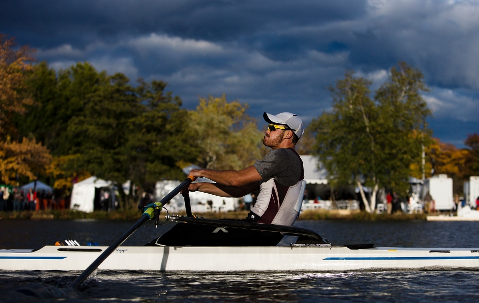 Leonard Futterman of Vesper Boat Club sculls past Hospitality Row in the Men's Championship Singles at the Head of the Charles rowing regatta in Boston, Massachusetts on October 17th 2015.