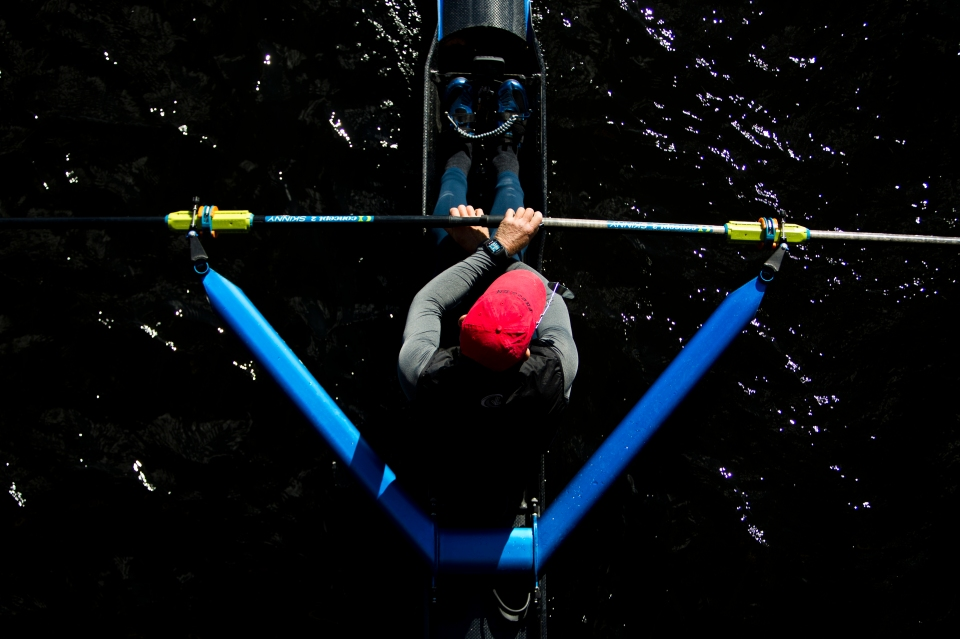 A single sculler goes for a practice row pro to the Head of the Charles rowing regatta in Boston, Massachusetts on October 16th 2015.