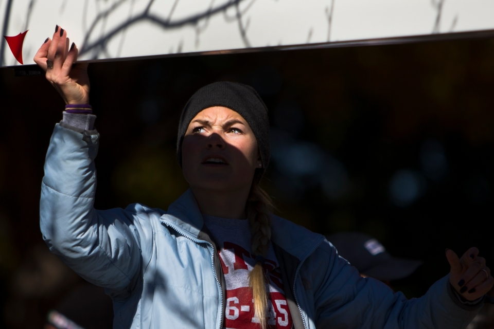 Bates Mens Rowing Team coxswain Marit Wettstein directs the boat back onto the trailer following their race in the Men's Collegiate Eights event at the Head of the Charles rowing regatta in Boston, Massachusetts on October 18th 2015.