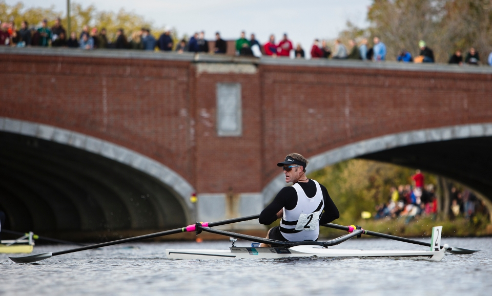 Mahe Drysdale of West End rowing club in New Zealand looks over his left shoulder in the Men's Championship Singles event after passing under Eliot Bridge at the Head of the Charles rowing regatta in Boston, Massachusetts on October 17th 2015.