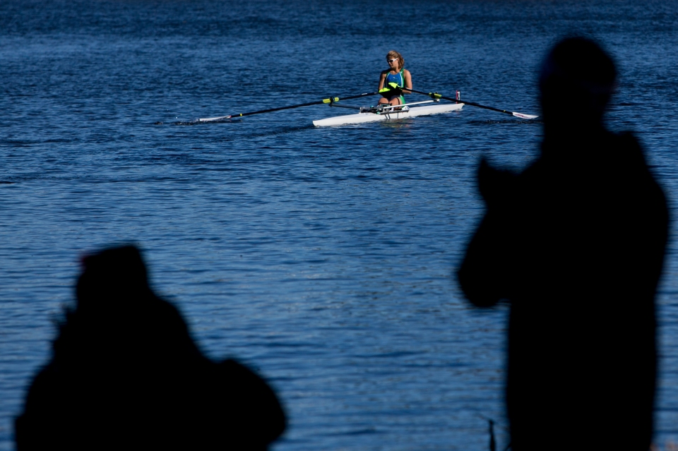 Sandra San Emeterio of Riverfront Recapture rowing club rows to the start of the Women's lightweight single event at the Head of the Charles rowing regatta in Boston Massachusetts on October 19th 2015.