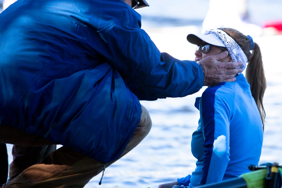 Whitemarsh Boat Club Coach Joseph Sullivan gives rower Gillian George some final words before pushing them off the dock prior to the Women's Youth Fours event at the Head of the Charles rowing regatta in Boston, Massachusetts on October 19th 2015.