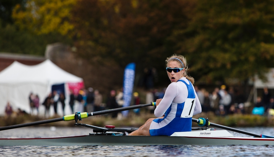 Genevra Stone of Cambridge rowing club looks over her shoulder in the Women's Championship Singles event at the final turn of the Head of the Charles rowing regatta in Boston, Massachusetts on October 19th 2015.