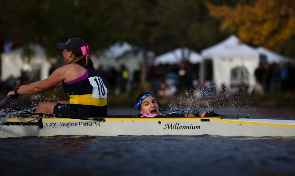 Mass. Maritime coxswain James Lucenta yells instructions to bowseat Laura Hahn as he completes the final turn around Eliot Bridge in the Women's Collegiate Fours event at the Head of the Charles rowing regatta in Boston Massachusetts on October 17th 2015.