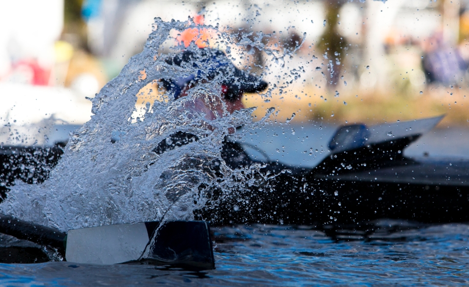 Marietta College's coxswain Patrick Specht gets splashed by bowman Ethan Schafhausen as he completes the final turn around Eliot Bridge in the Men's Collegiate Fours event at the Head of the Charles rowing regatta in Boston Massachusetts on October 17th 2015.
