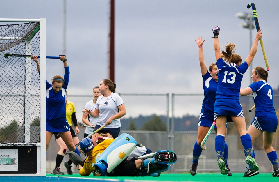 University of British Columbia Thunderbird celebrate their first of two goals in a 3-2 victory (3-1 in penalty shots) over the University of Victoria Vikes in the gold medal match of the CIS Women's Field Hockey Championships claiming their fifth straight McCrae Cup on November 8th, 2015 in Victoria, British Columbia, Canada. On the play Uvic defender Lizzie Yates caught goalkeeper Lizzie Yates goal stick in the head causing her to receive medical attention. Yates remained in the game scoring a goal for the Vikes. #16 Larissa Piva