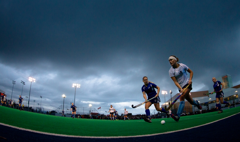 University of Victoria Vike Lizzie Yates runs down the sideline away from University of British Coiumbia Thundersbird Alyssa Nonis in the gold medal match of the CIS Women's Field Hockey Championships on November 8th, 2015 in Victoria, British Columbia, Canada.