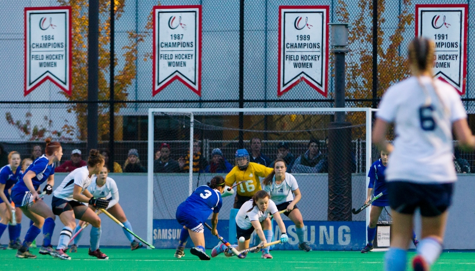 University of British Columbia Thunderbird Gabby Jayme  puts a shot on Uvic goalkeeper Larissa Piva in the last minute of the gold medal match of the CIS Women's Field Hockey Championships versus the University of Victoria on November 8th, 2015 in Victoria, British Columbia, Canada.