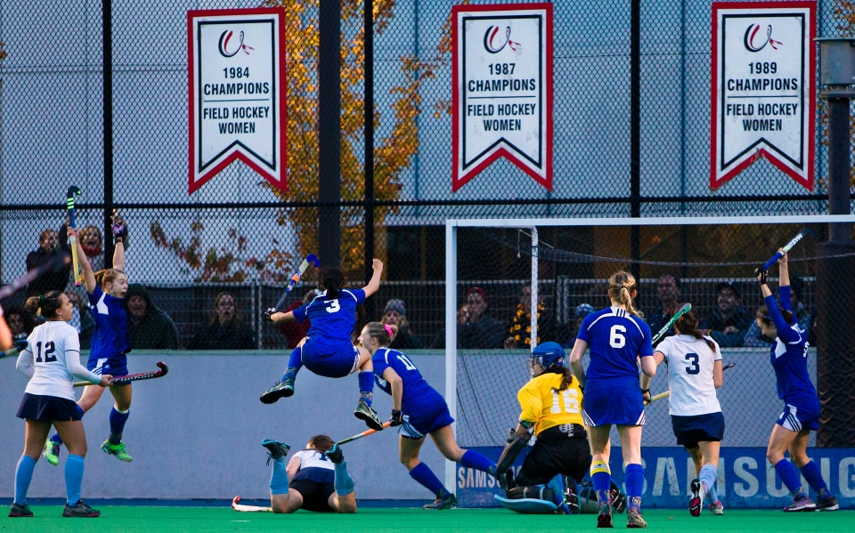 University of British Columbia Thunderbird Hannah Haughn and #3 Gabby Jayme jump into the air following a last minute game tying goal in the gold medal match of the CIS Women's Field Hockey Championships versus the University of Victoria on November 8th, 2015 in Victoria, British Columbia, Canada.