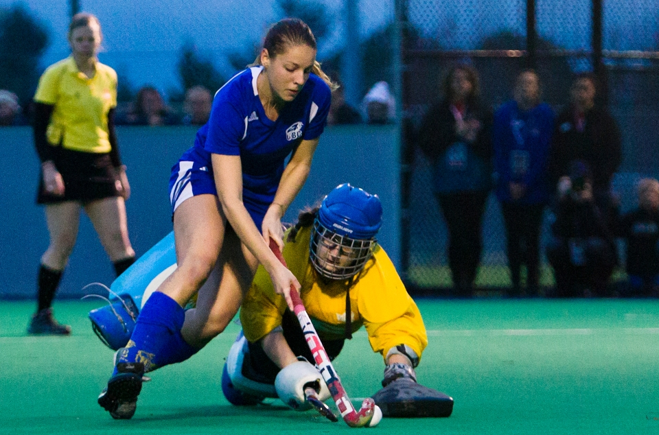 University of British Columbia Thunderbird Sarah Keglowitsch scores a penalty shot goal on Uvic goalkeeper Larissa Piva during the gold medal match of the CIS Women's Field Hockey Championships on November 8th, 2015 in Victoria, British Columbia, Canada.