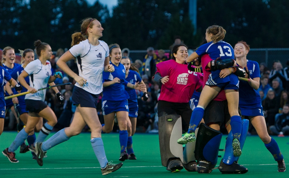 University of British Columbia Thunderbird Hannah Haughn jumps into the arms of goalkeeper Rowan Harris following a 3-2 victory (3-1 in penalty shots) over the University of Victoria Vikes in the gold medal match of the CIS Women's Field Hockey Championships claiming their fifth straight McCrae Cup on November 8th, 2015 in Victoria, British Columbia, Canada.