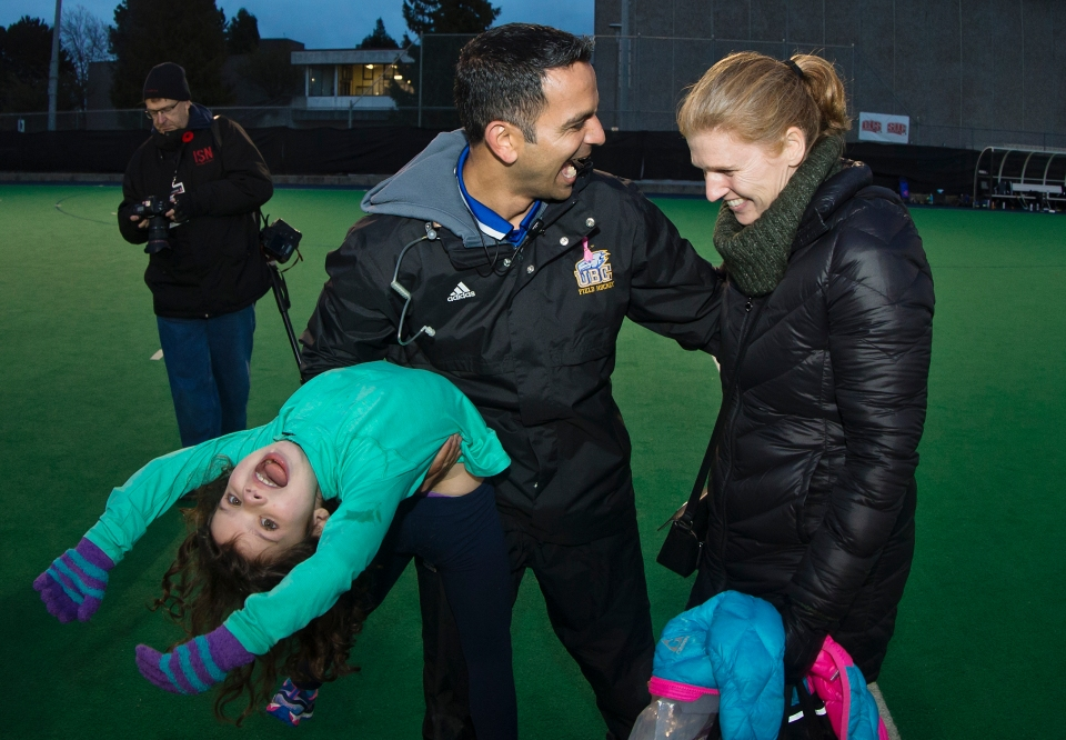 University of British Columbia Thunderbird Head Coach Robin D'Abreo celebrates with his family following a 3-2 victory (3-1 in penalty shots) over the University of Victoria Vikes in the gold medal match of the CIS Women's Field Hockey Championships claiming their fifth straight McCrae Cup on November 8th, 2015 in Victoria, British Columbia, Canada.