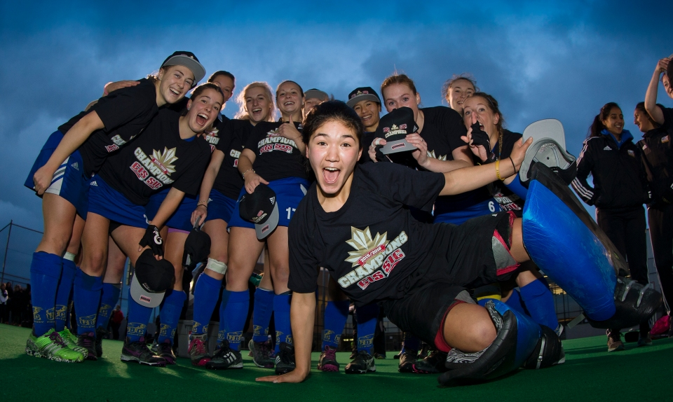University of British Columbia Thunderbird goalkeeper Rowan Harris jumps in for a team photo following a 3-2 victory (3-1 in penalty shots) over the University of Victoria Vikes in the gold medal match of the CIS Women's Field Hockey Championships claiming their fifth straight McCrae Cup on November 8th, 2015 in Victoria, British Columbia, Canada.