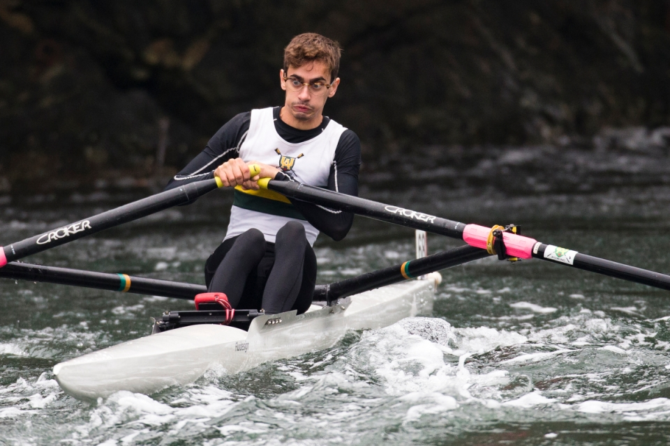 Rolland Dennett of Edmonton Rowing Club rows through the Gorge Narrows in a single sculling shell on his was to the start line of the Head of the Gorge Regatta on October 24, 2015 in Victoria British Columbia, Canada. The Gorge Narrows was formerly a reversing tidal waterfall, until a large rock was blasted from the narrows in 1960. The falls were greatly reduced but there is still enough flow during a tidal change to make it a challenge for rowers to get through.