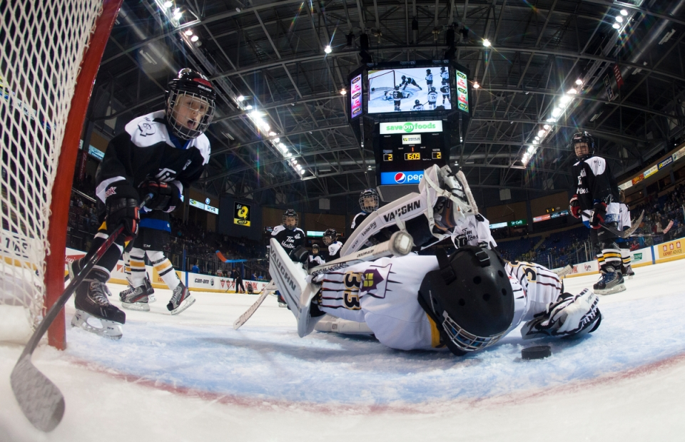 Victoria Grizzlies minor hockey team goaltender makes a glove save during the first intermission of a Western Hockey League game between the Victoria Royals and the Lethbridge Hurricanes at the Save-on-Foods Memorial centre on October 27, 2015 in Victoria, British Columbia Canada.