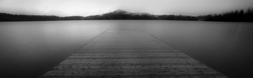 A dock sits empty on a rainy day.