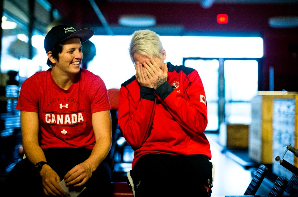 Brittany Benn (left) and Jen Kish share a laugh prior to the start of a team practice at the Pacific Institute for Sports Excellence in Victoria, British Columbia Canada on January 25, 2016. (Kevin Light/CBCSports)