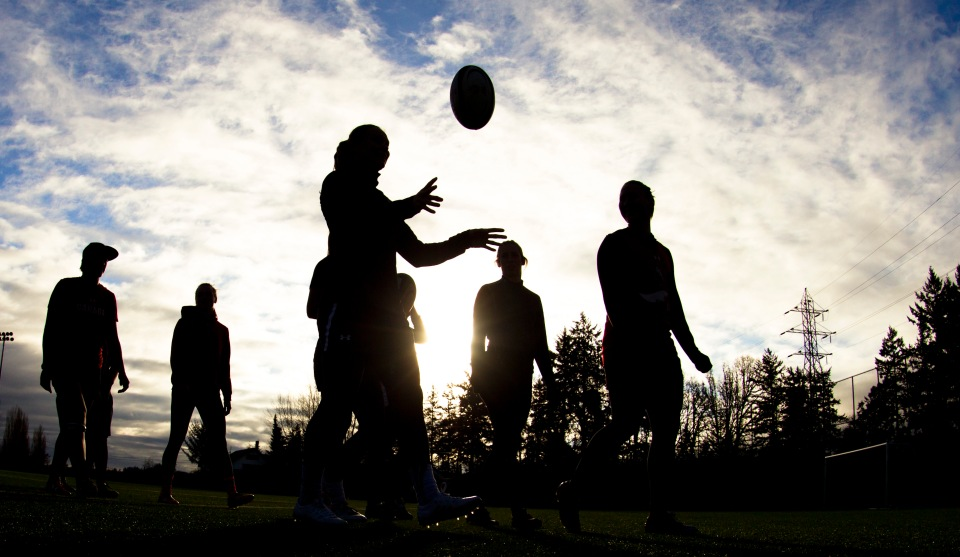 Karen Paquin tosses a rugby ball into the air prior to the start of a team practice at the Pacific Institute for Sports Excellence in Victoria, British Columbia Canada on January 25, 2016. (Kevin Light/CBCSports)