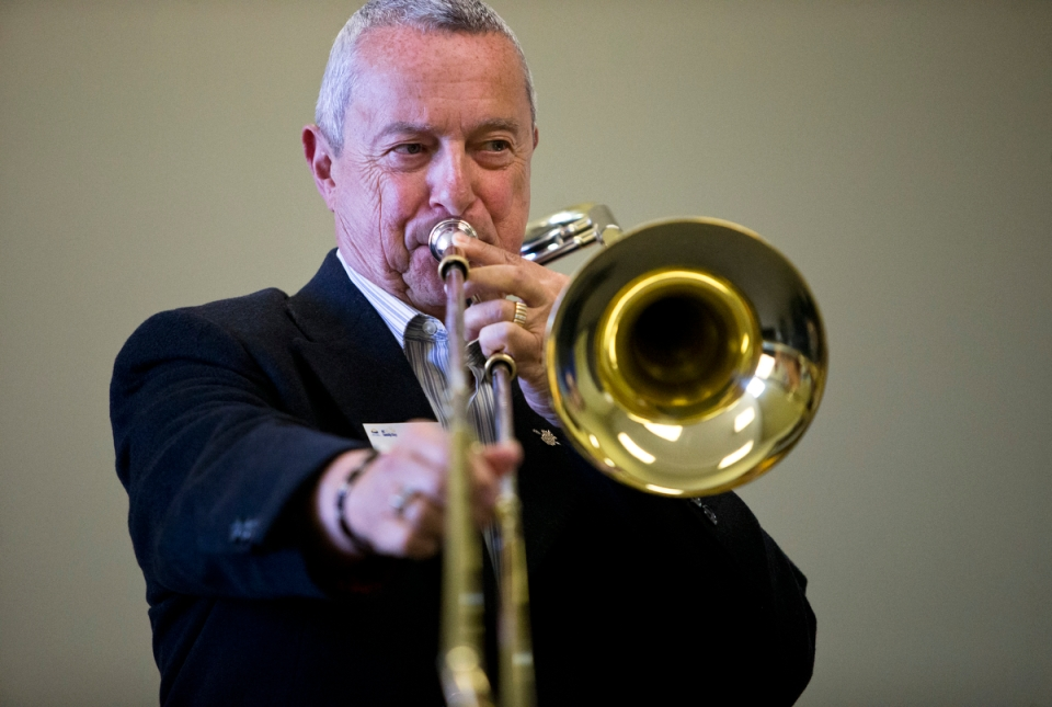 Peter Fassbender, Minister of Community, Sport and Cultural Development plays a trombone Kevin Light Photo