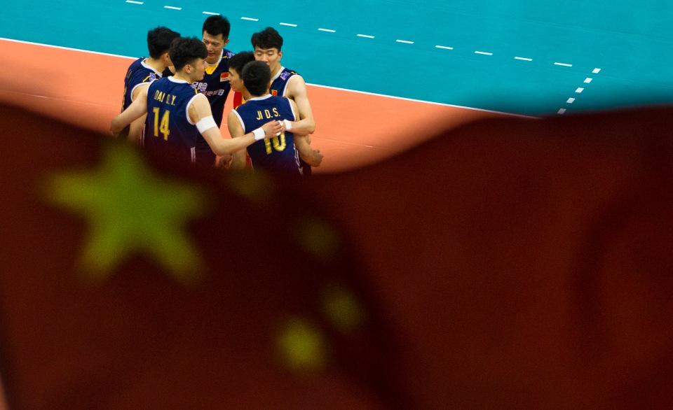 Qingyao Dai (14) and Daoshuai Ji (10) of China Volleyball Kevin LIght Photo