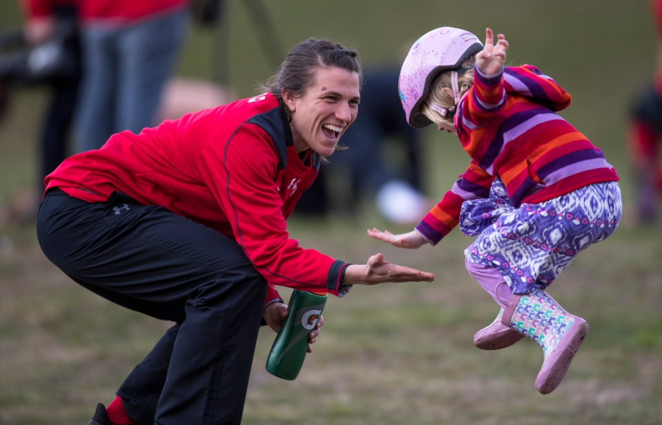 7 Julianne_Zussman_rugby_canada_zara_light_high_five_child_kid_jump_Kevin_Light_Photo_28
