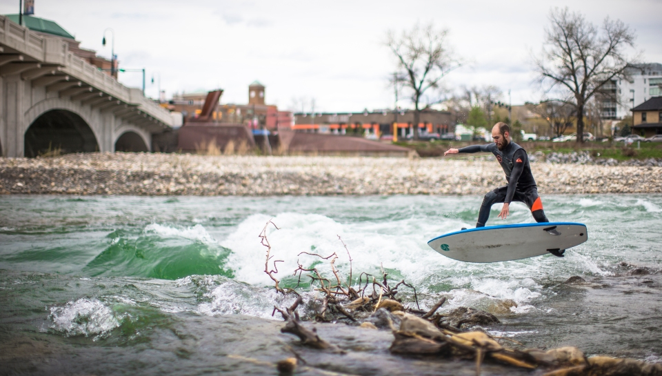 9 bow_River_surfer_Ryan_Morstad_surf_standing_wave_jump_calgary_Kevin_Light_Photo_30